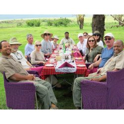 Group of travelers in the serengeti Africa