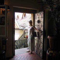 Lynn Cicarelli holding a door open in Prague